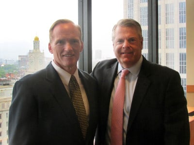 Jim Marlor (left) of New England Financial Group and David Porter (right) of Baystate Financial announced a merger of the two companies on July 19, 2017.