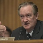 Senate Banking Committee member Sen. Mike Crapo, R-Idaho questions Wells Fargo Chief Executive Officer John Stumpf, on Capitol Hill in Washington, Tuesday, Sept. 20, 2016, during the committee's hearing. Stumpf was called before the committee for betraying customers' trust in a scandal over allegations that employees opened millions of unauthorized accounts to meet aggressive sales targets. (AP Photo/Susan Walsh) ORG XMIT: DCSW129
